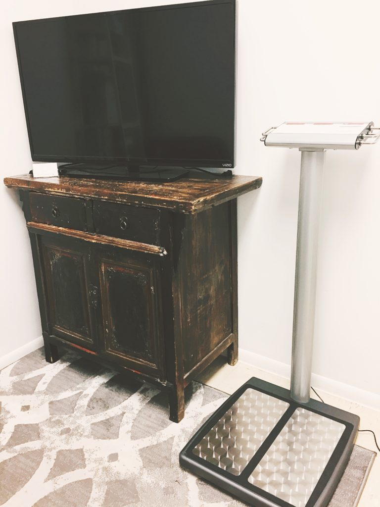 Rx Weight Loss image of our new scale along with a tv and cabinet